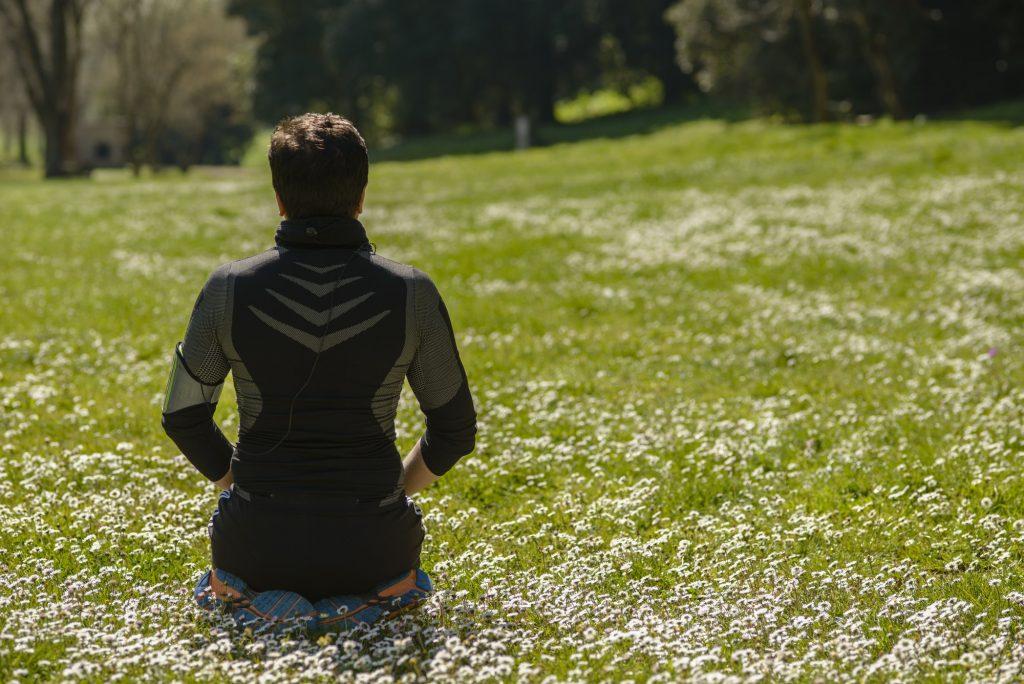 Man sitting on grass for meditation